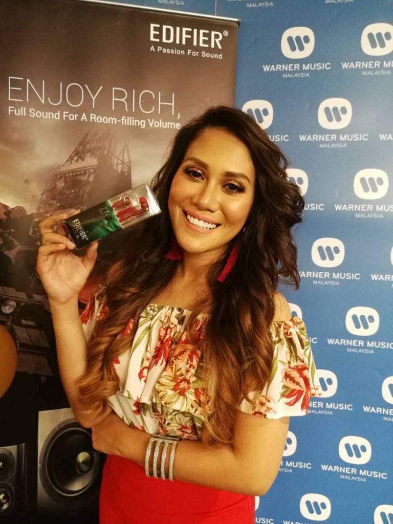 Malaysia artist Bella Nazari holding an Edifier P275 earpphone
